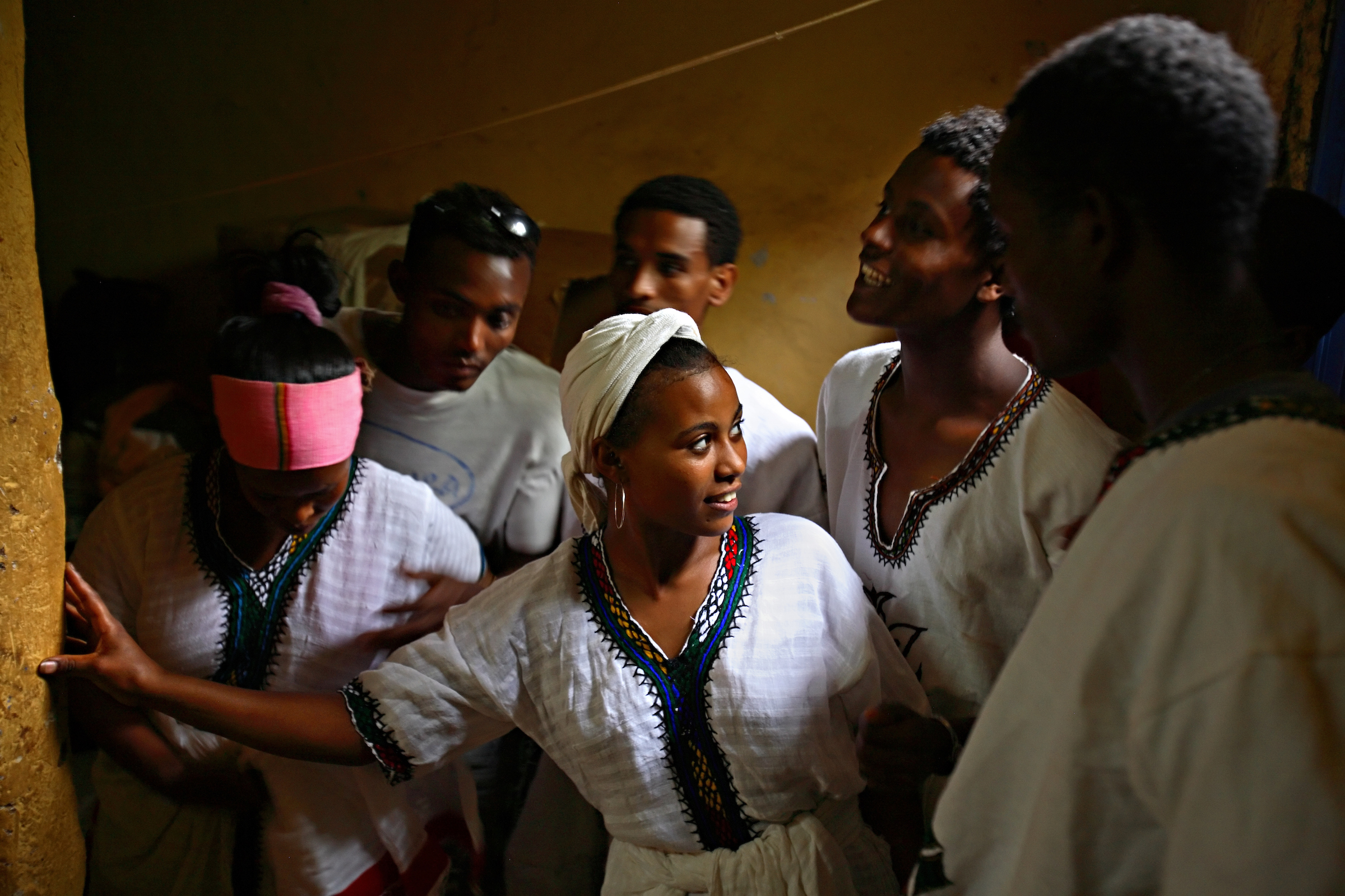 Members of the Fistula Girls Club and the Community-based Reproductive Association,  perform a traditional dance against child marriage in Shende, Ethiopia