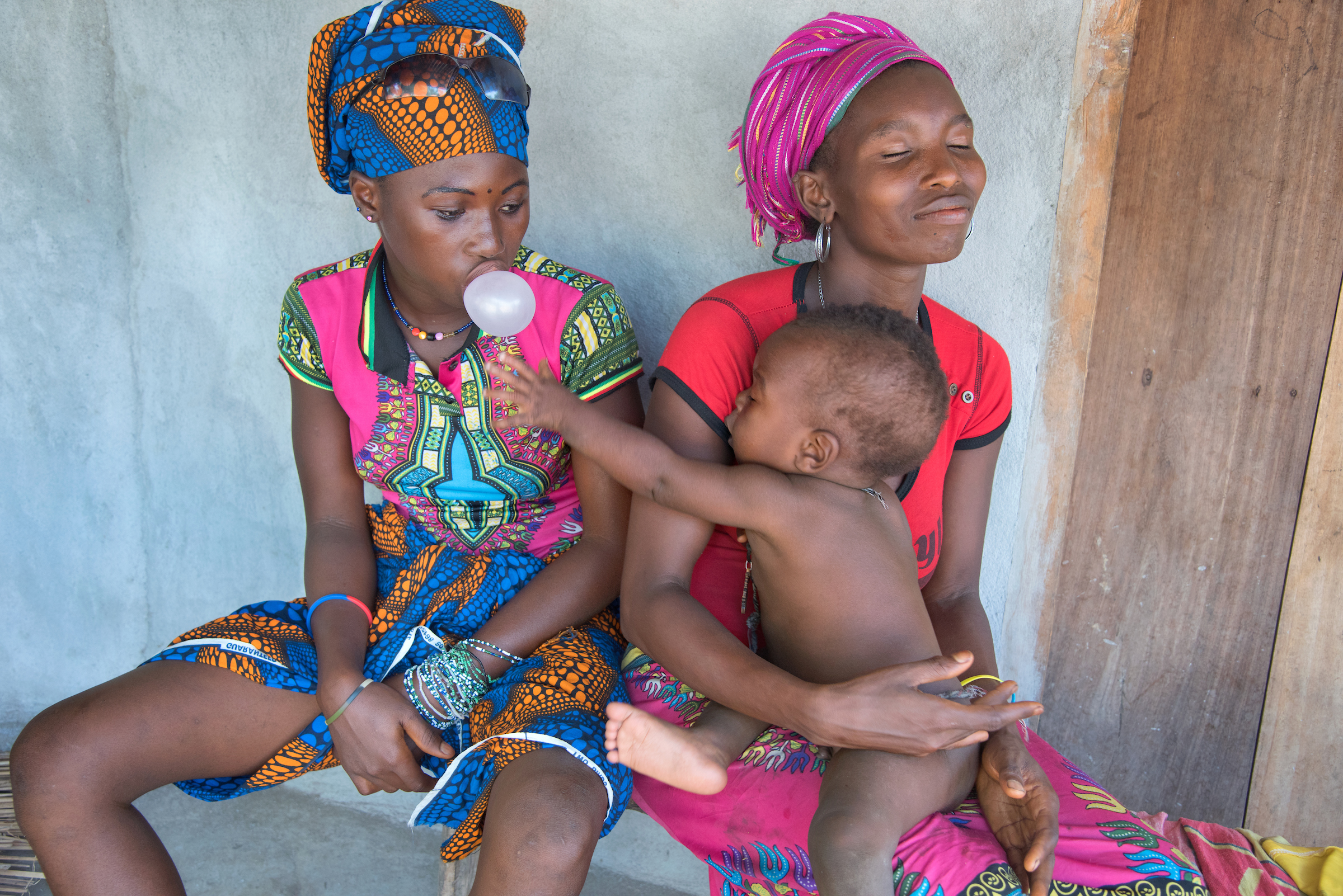 Fatmata, 15, sits with her 9-month- old son, Isa, in a small village outside of Kambia, Sierra Leone.