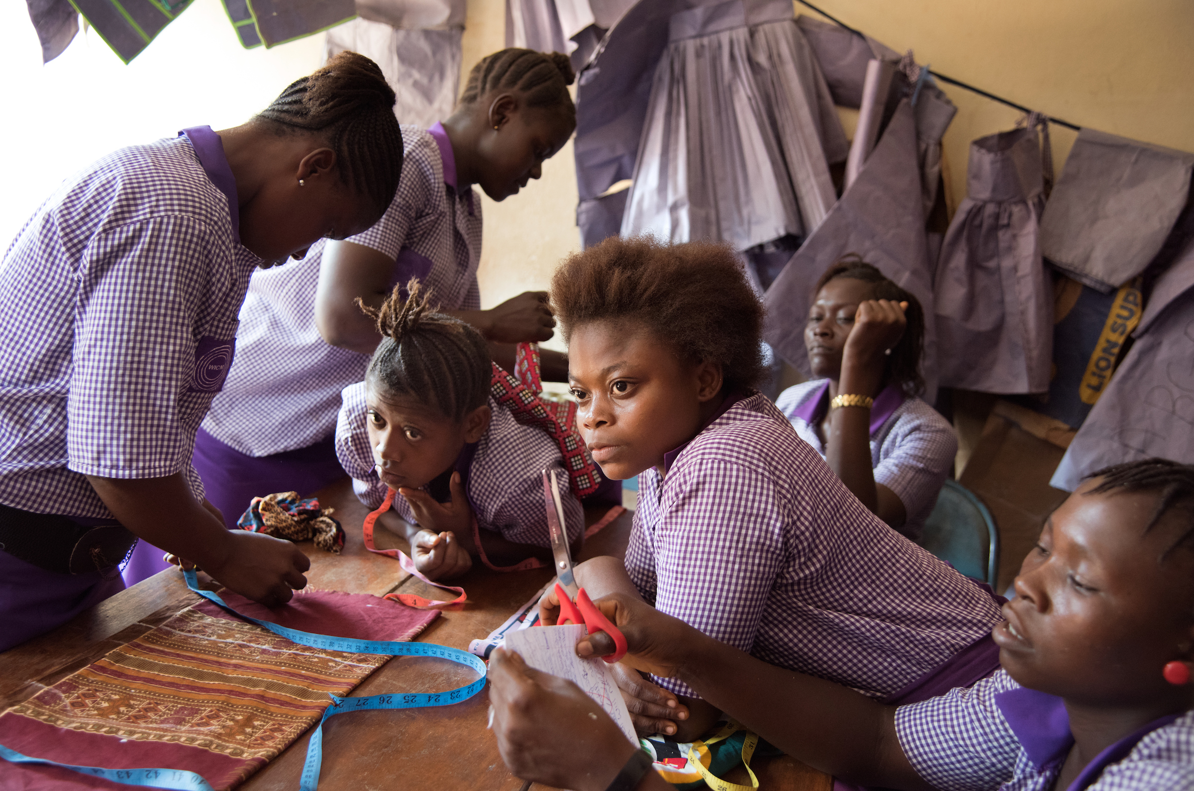 Adolescent girls take part in sewing classes offered by Women in Crisis in Freetown, Sierra Leone.